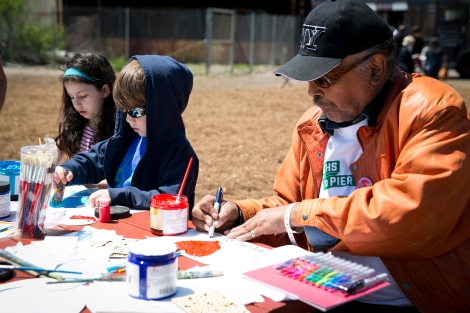 GOLES member Luther Stubblefield and other young community members paint their ideal park - photo by Whitney Browne