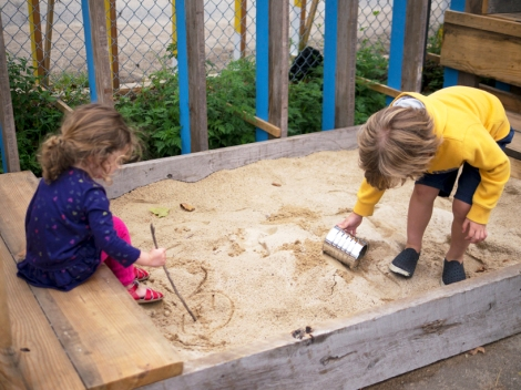 Children play in the sandbox