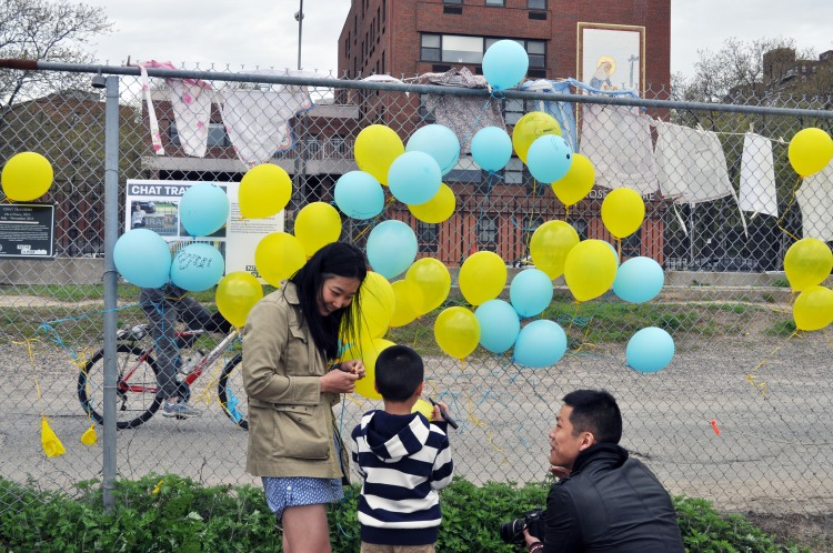 Yeju Choi speaks to local residents about their ideas for the 2014 expansion of
