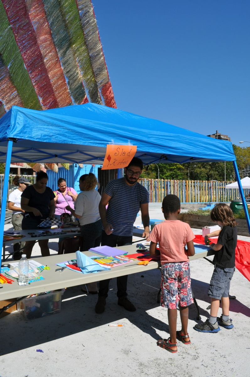 Making kites with Two Bridges Neighborhood Council at the Fall Festival