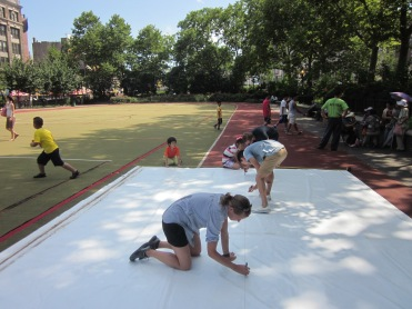Creating flags out of recycled billboard vinyl in Sara D. Roosevelt Park, Spring 2013.
